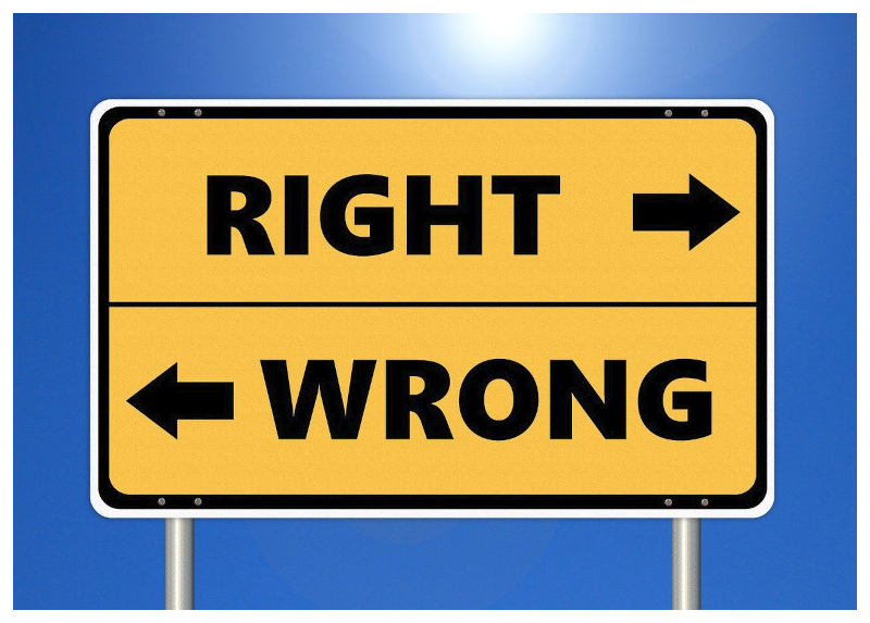 A road sign pointing to right and wrong